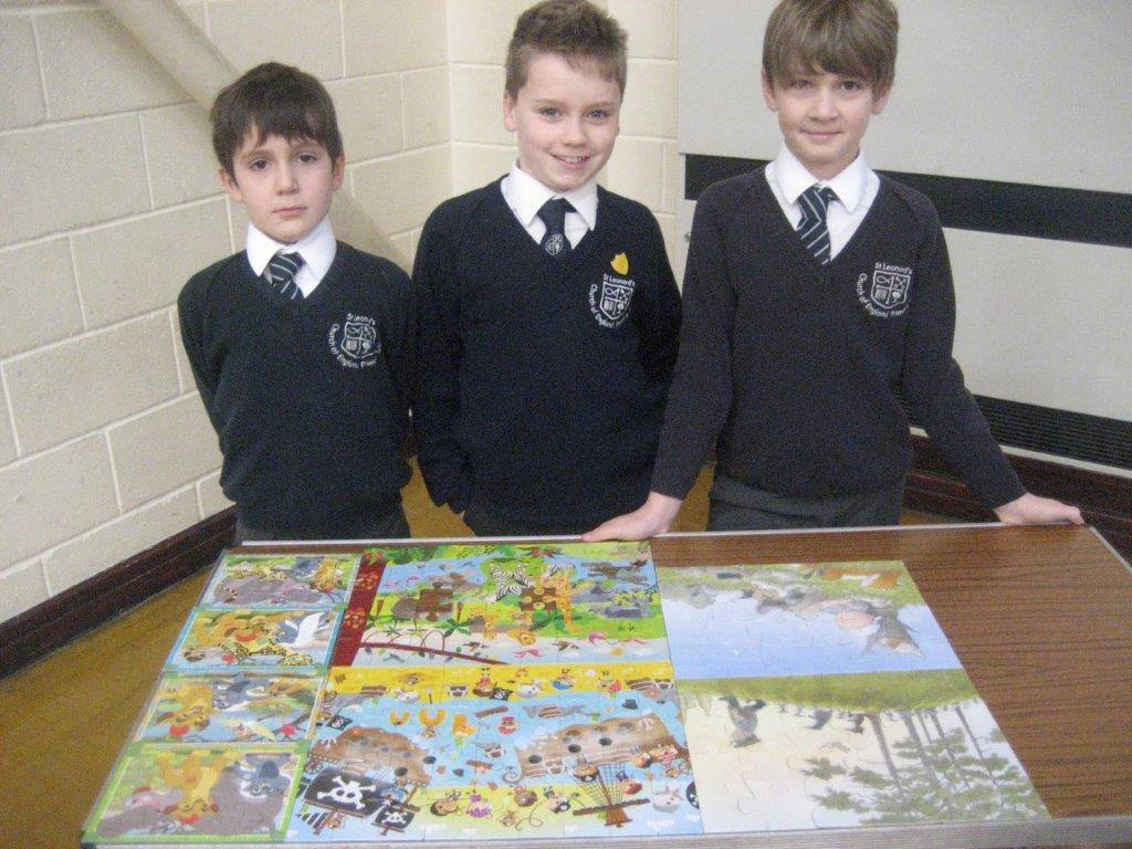 children with completed jigsaws