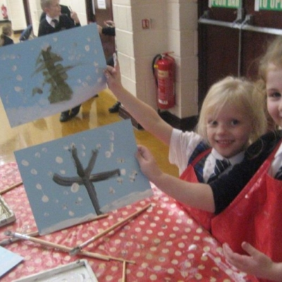 children showing off their chirstmas paintings