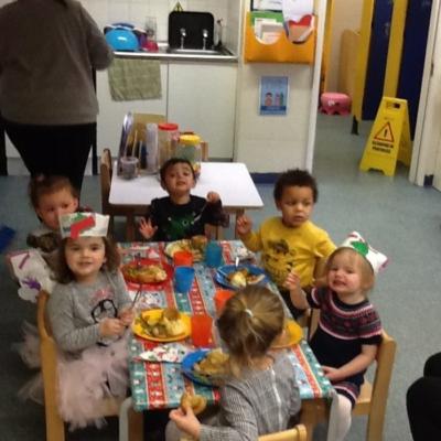 enjoying christmas dinner at nursery