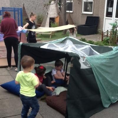 children sat in their den