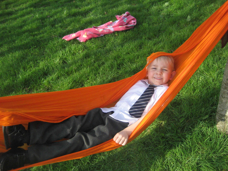 relaxing smiling in hammock outside