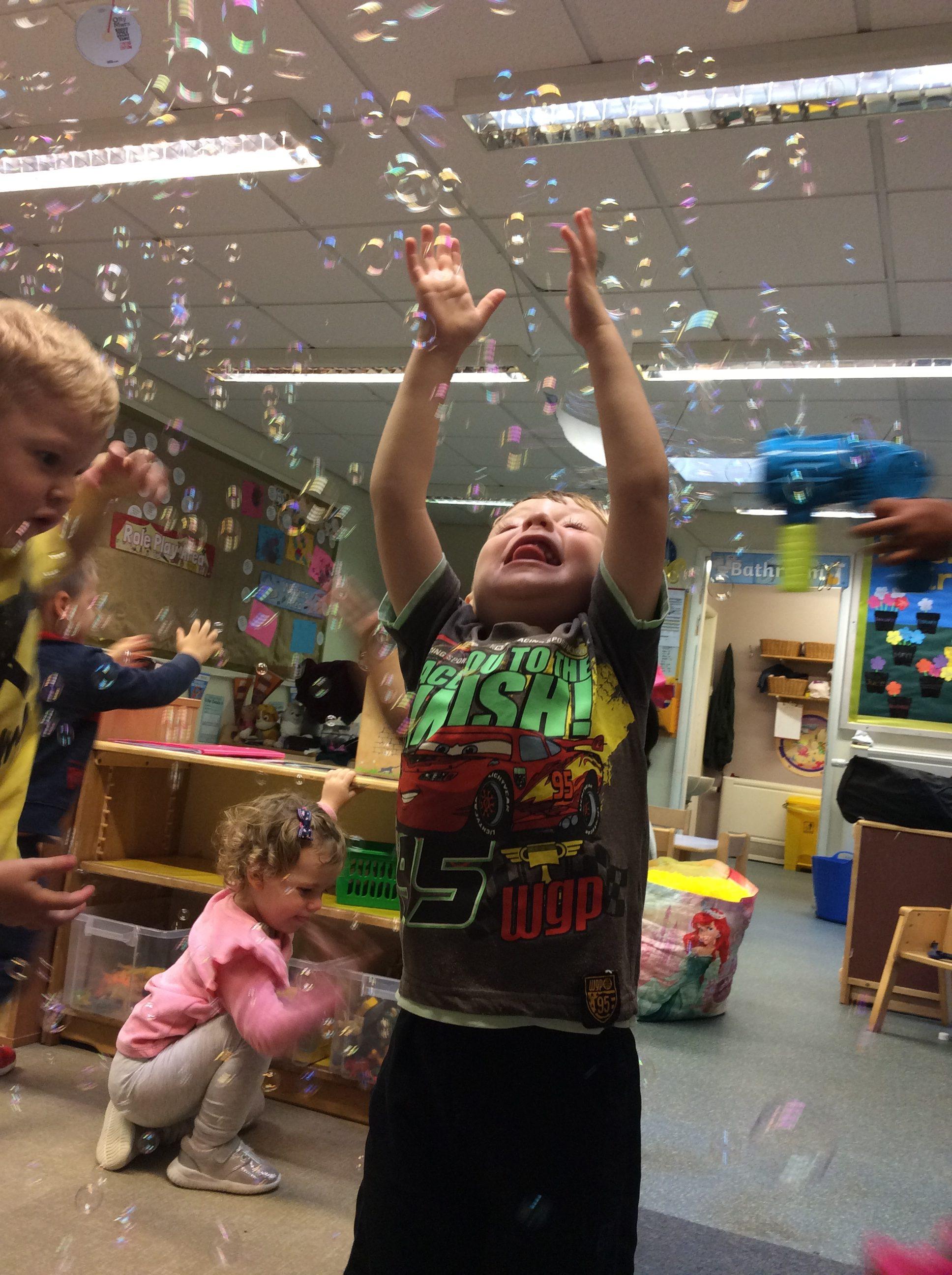 bubble catching fun at nursery