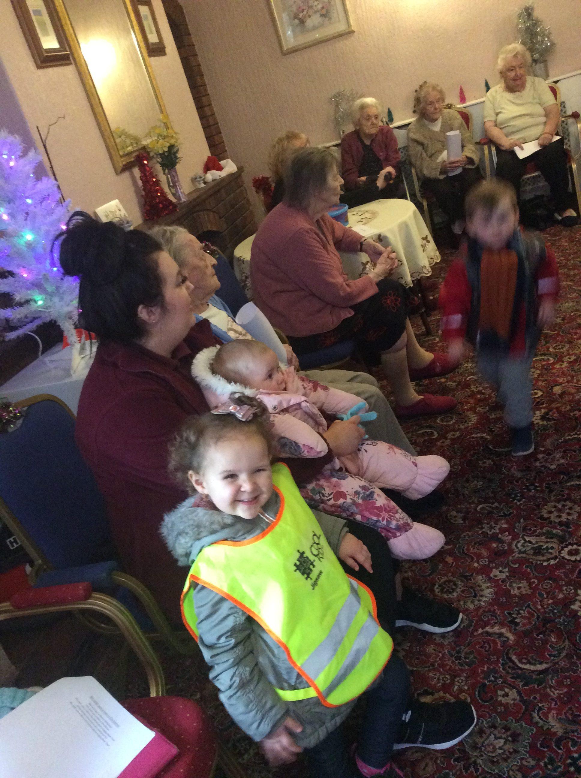 children visiting nursing home with nursery